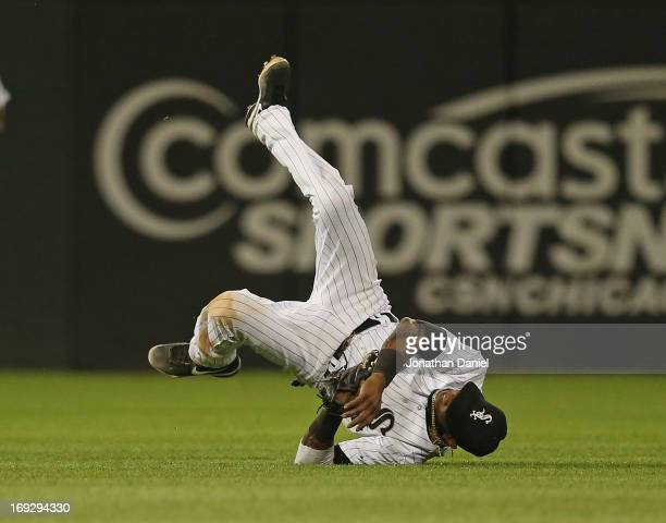 Alexei Ramirez of the Chicago White Sox flips over after making a catch on a ball hit by Stephen Drew of the Boston Red Sox in the 7th inning at US...