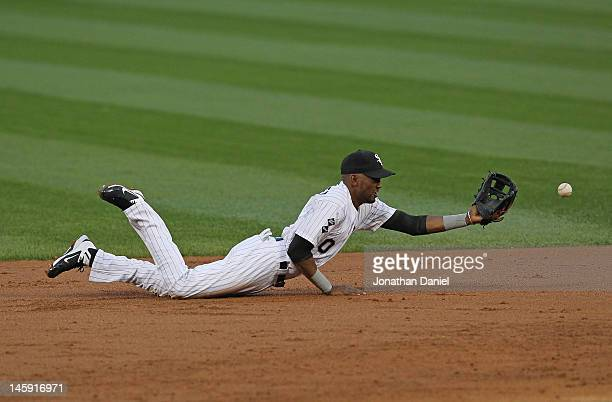 Alexei Ramirez of the Chicago White Sox flips the ball after making a diving catch against the Toronto Blue Jays at US Cellular Field on June 7 2012...