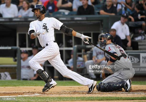 Alexei Ramirez of the Chicago White Sox follows through on a solo home run as catcher Lou Marson of the Cleveland Indians watches during the second...