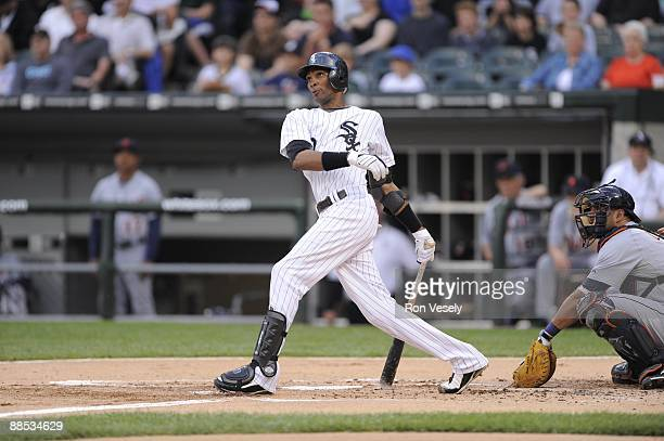 Alexei Ramirez of the Chicago White Sox follows through on his first inning home run against the Detroit Tigers during the second game of a day-night...