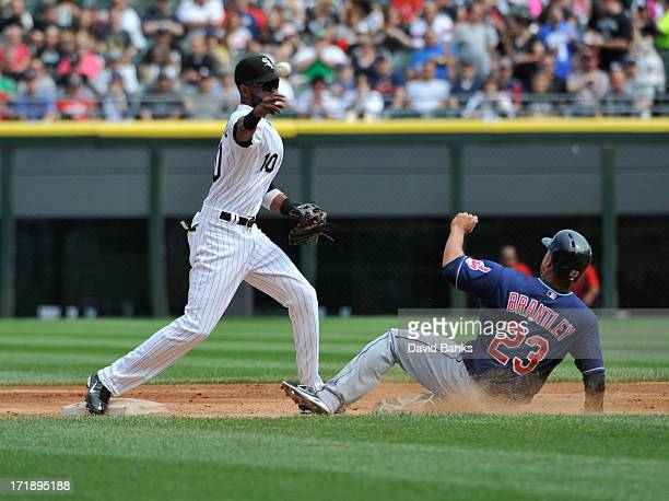 Alexei Ramirez of the Chicago White Sox forces out Michael Brantley of the Cleveland Indians at second base during the second inning on June 29 2013...