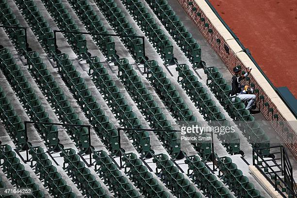 Alexei Ramirez of the Chicago White Sox gestures to teammates with a baseball as he sits in the stands before playing the Baltimore Orioles at an...