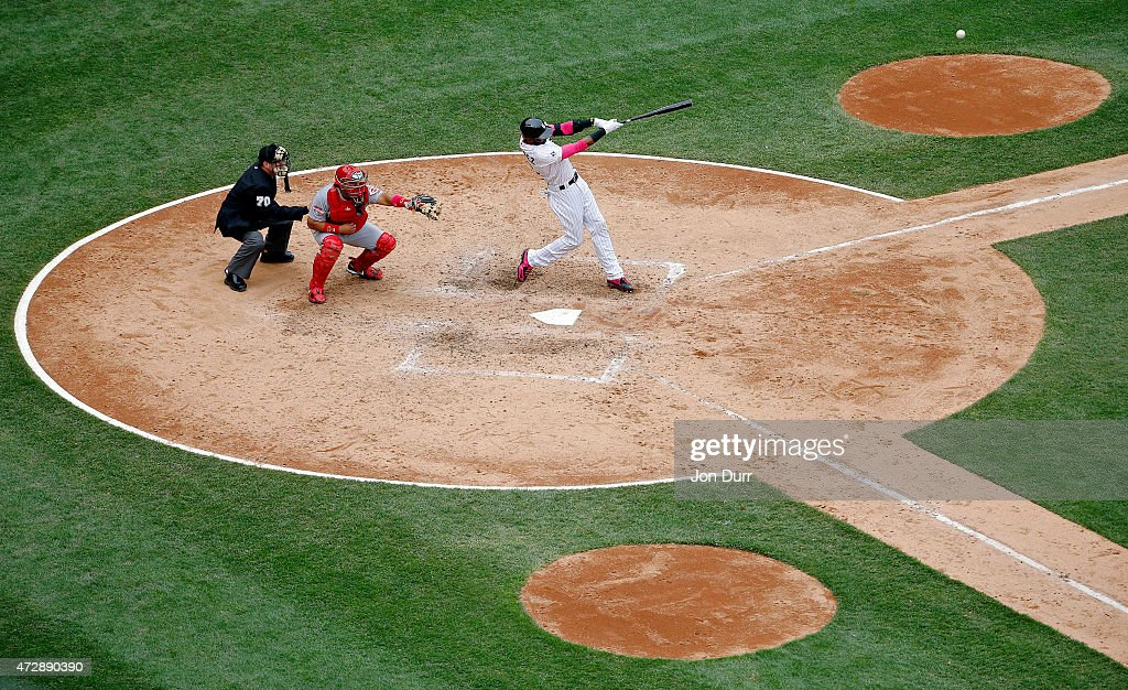 Alexei Ramirez #10 of the Chicago White Sox hits a sacrifice fly against the Cincinnati Reds during the eighth inning to bring in Jose Abreu #79 (not pictured) on May 10, 2015 at U.S. Cellular Field in Chicago, Illinois. The Chicago White Sox won 4-3.