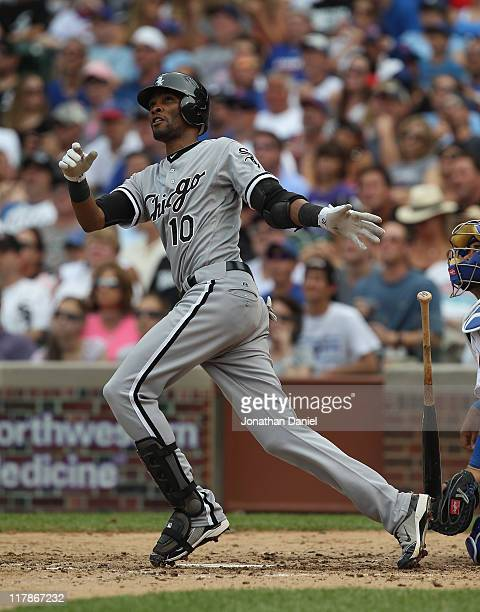Alexei Ramirez of the Chicago White Sox hits a tworun home run in the 7th inning against the Chicago Cubs at Wrigley Field on July 1 2011 in Chicago...