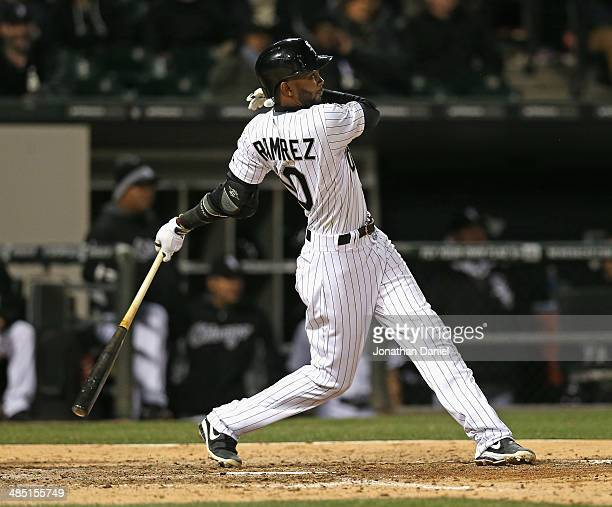 Alexei Ramirez of the Chicago White Sox hits a tworun home run in the 6th inning against the Boston Red Sox at US Cellular Field on April 16 2014 in...