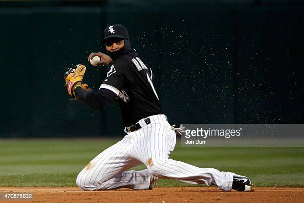Alexei Ramirez of the Chicago White Sox is unable to make the throw to first base against the Kansas City Royals during the third inning on April 23...