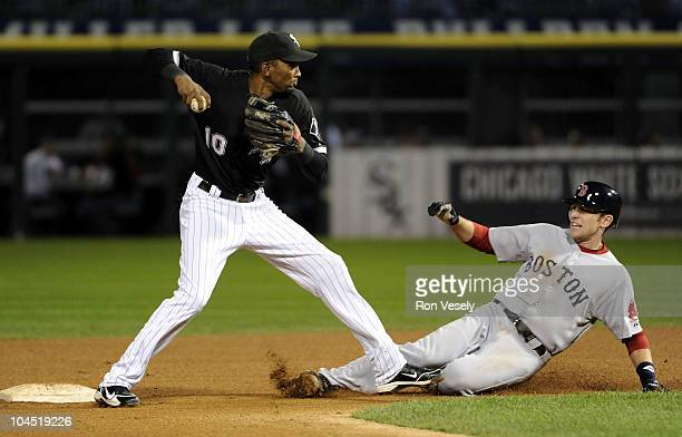 Alexei Ramirez of the Chicago White Sox makes a forced out at second base as Jed Lowrie of the Boston Red Sox slides late on September 28 2010 at US...