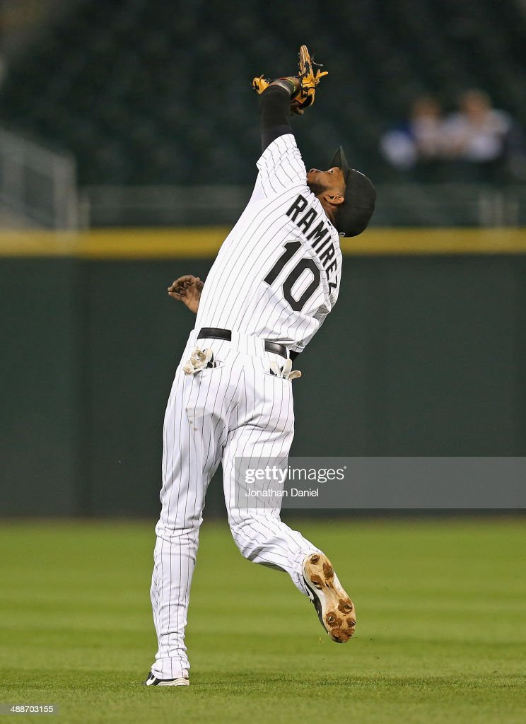 Alexei Ramirez #10 of the Chicago White Sox makes an over-the-shoulder catch on a ball hit by Welington Castillo of the Chicago Cubs on the first out of a double play in the 9th inning at U.S. Cellular Field on May 7, 2014 in Chicago, Illinois. The White Sox defeated the Cubs 8-3.