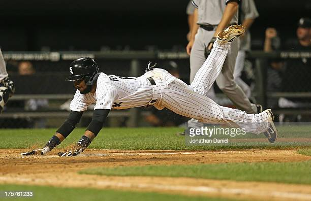Alexei Ramirez of the Chicago White Sox scores the gamewinning run in the 12 inning against the New York Yankees at US Cellular Field on August 7...