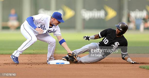 Alexei Ramirez of the Chicago White Sox slides into second base for a double past the tag of Elliot Johnson of the Kansas City Royals in the first...