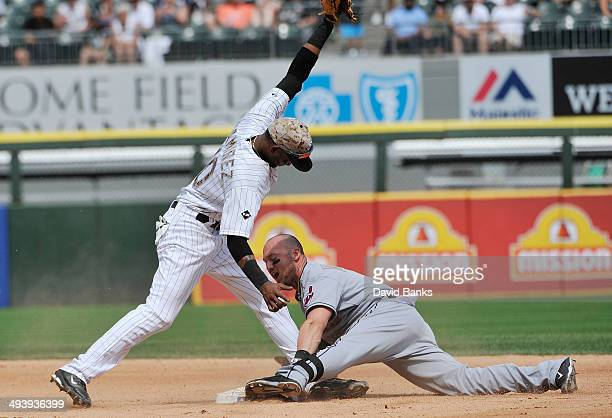 Alexei Ramirez of the Chicago White Sox tags out Ryan Raburn of the Cleveland Indians at second base during the sixth inning on May 26, 2014 at U.S....