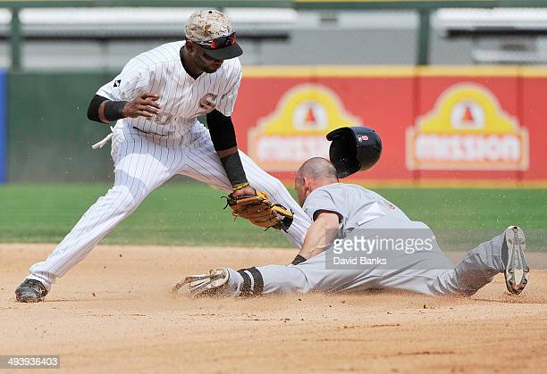 Alexei Ramirez of the Chicago White Sox tags out Ryan Raburn of the Cleveland Indians at second base during the sixth inning on May 26 2014 at US...