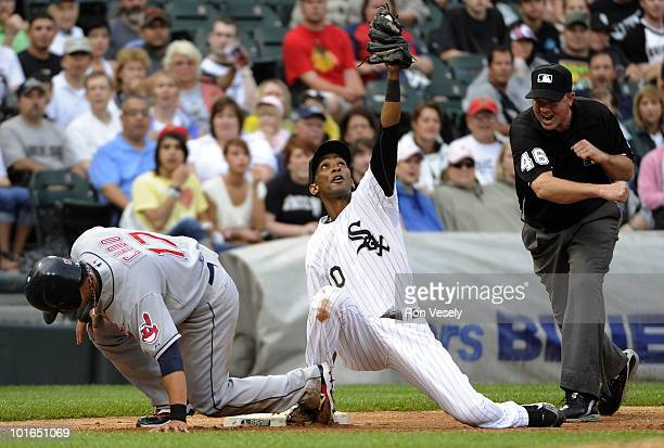Alexei Ramirez of the Chicago White Sox tags out ShinSoo Choo of the Cleveland Indians at third base as third base umpire Ron Kulpa makes the call on...