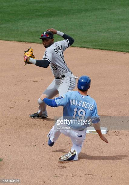 Alexei Ramirez of the Chicago White Sox throws past Danny Valencia of the Kansas City Royals to first but can't complete a double play in the sixth...