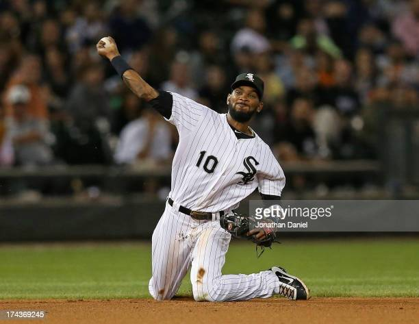 Alexei Ramirez of the Chicago White Sox tries to throw out Hernan Perez of the Detroit Tigers from his knees at US Cellular Field on July 24 2013 in...
