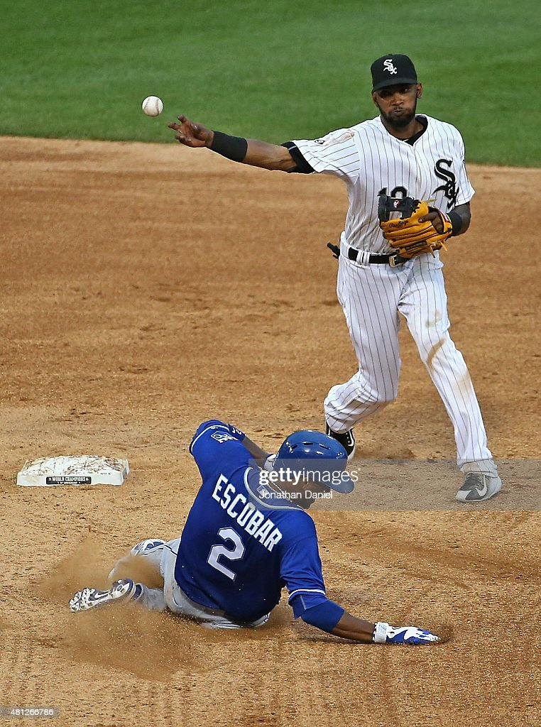 Alexei Ramirez #10 of the Chicago White Sox turns a double play over Alcides Escobar #2 of the Kansas City Royals at U.S. Cellular Field on July 18, 2015 in Chicago, Illinois. The Royals defeated the White Sox 7-6 in 13 innings.