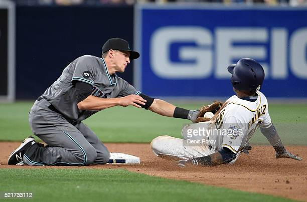 Alexei Ramirez of the San Diego Padres is tagged out by Nick Ahmed of the Arizona Diamondbacks as he tries to steal second base during the ninth...