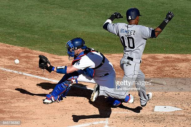 Alexei Ramirez of the San Diego Padres scores in the fifth inning against Yasmani Grandal of the Los Angeles Dodgers at Dodger Stadium on July 9 2016...