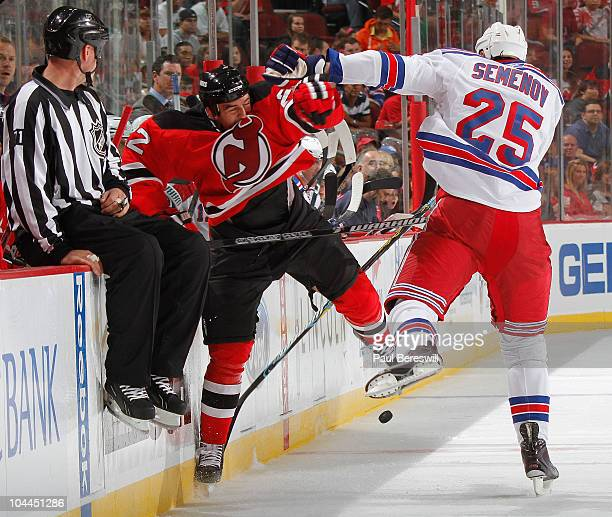 Alexei Semenov of the New York Rangers collides with PL LetourneauLeblond of the New Jersey Devils in the first period of a preseason hockey game at...