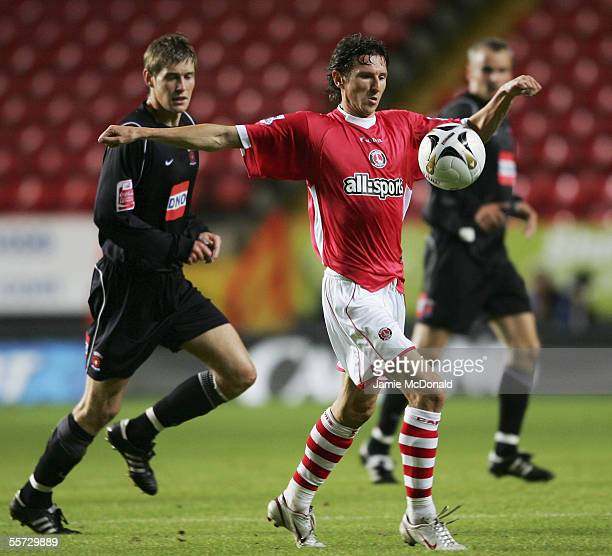 Alexei Smertin of Charlton Athletic shields the ball from Antony Sweeney of Hartlepool United during the Carling Cup second round match between...