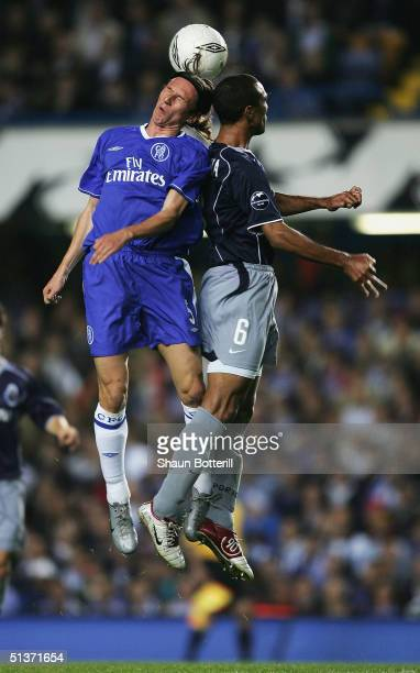 Alexei Smertin of Chelsea jumps for the ball with Costinha of FC Porto during the UEFA Champions League Group H match between Chelsea and FC Porto at...