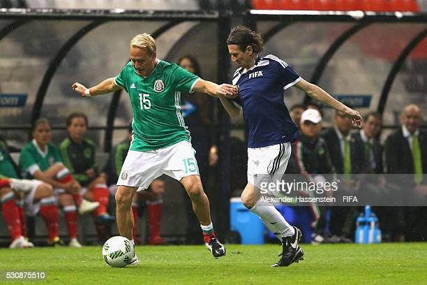 Alexei Smertin of FIFA Legends battles for the ball with Luis Hernandez of MexicanAllstars during an exhibition match between FIFA Legends and...