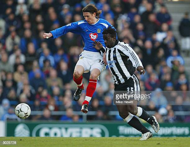 Alexei Smertin of Portsmouth battles for the ball with Oliver Bernard of Newcastle United during the FA Barclaycard Premiership match between...