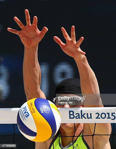 Alexei Strasser of Switzerland blocks the ball in the Men's Beach Volleyball semi final during day nine of the Baku 2015 European Games at the Beach...