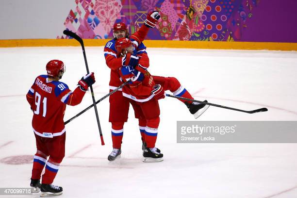 Alexei Tereshchenko of Russia celebrates with his teammates Vladimir Tarasenko and Victor Tikhonov after scoring a goal in the third period against...