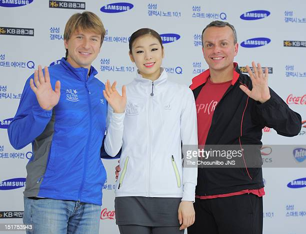 Alexei Yagudin Kim YuNa and David Wilson pose for photographs during 'All That Skate Summer 2012' at Olympic Gymnastics Stadium on August 26 2012 in...