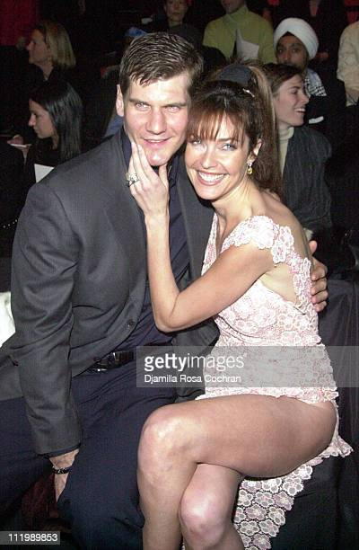 Alexei Yashin and Carol Alt during Mercedes Benz Fashion Week Fall 2003 Collections Luca Luca Front Row at Bryant Park in New York City New York...