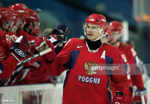 Alexei Yashin of Russia celebrates with his teammates after Russia scored during the men's ice hockey Preliminary Round Group B match between Russia...