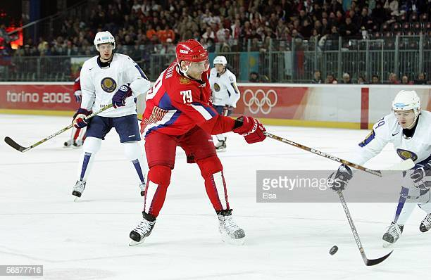 Alexei Yashin of Russia passes against the defense of Kazakhstan during the men's ice hockey Preliminary Round Group B match during Day 8 of the...