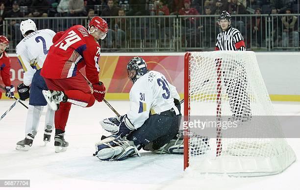 Alexei Yashin of Russia pressures goalkeeper Vitaliy Yeremeyev of Kazakhstan during the men's ice hockey Preliminary Round Group B match during Day 8...