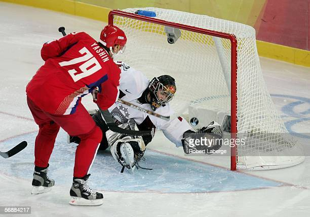 Alexei Yashin of Russia scores past Goalkeeper Sergejs Naumovs of Latvia during the men's ice hockey Preliminary Round Group B match between Russia...