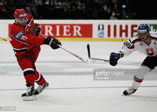 Alexei Yashin of Russia takes a shot in front of Marian Gaborik of Slovakia in the IIHF World Men's Championships preliminary round group A game at...