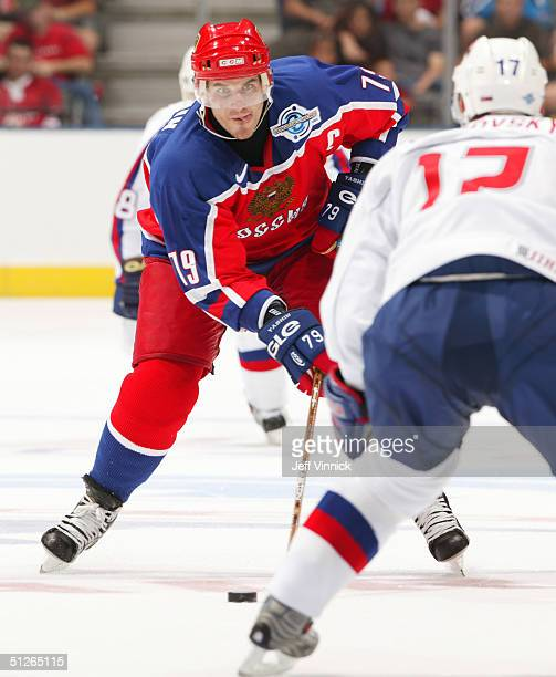 Alexei Yashin of Team Russia stares down Lubomir Viisnovsky of Team Slovakia as he carries the puck up the ice during the third period of their game...