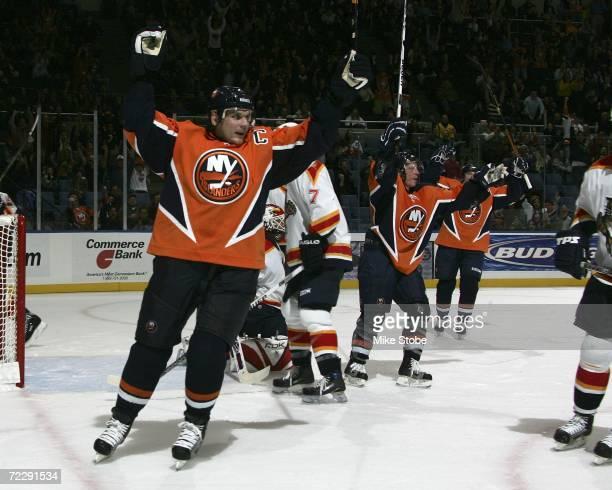 Alexei Yashin of the New York Islanders celebrates teammates Jason Blake's second period goal against the Florida Panthers during their game on...