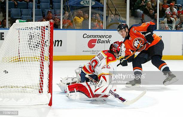 Alexei Yashin of the New York Islanders scores a first period goal against Ed Belfour of the Florida Panthers during their game on October 28, 2006...