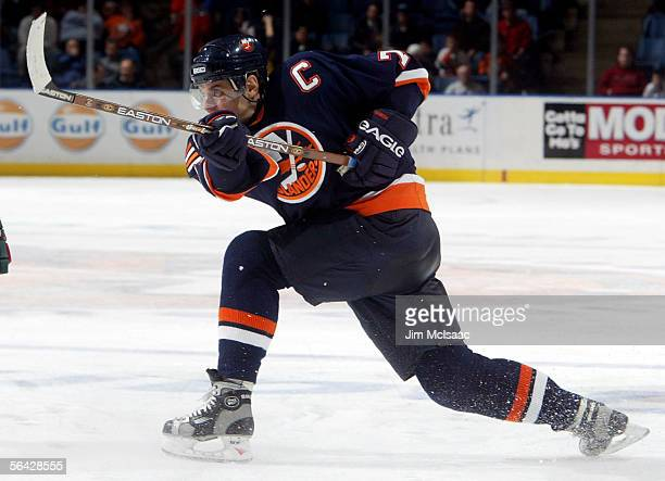 Alexei Yashin of the New York Islanders shoots the puck against the Minnesota Wild during their game on December 13, 2005 at Nassau Coliseum in...