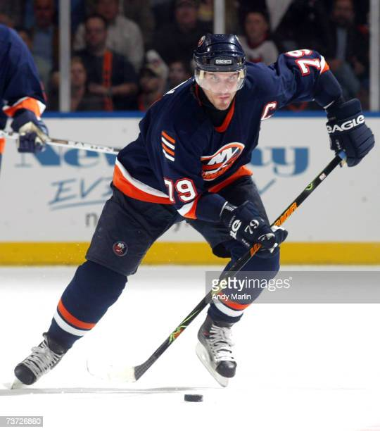 Alexei Yashin of the New York Islanders skates with the puck against the New Jersey Devils during their game at the Nassau Coliseum on March 27, 2007...