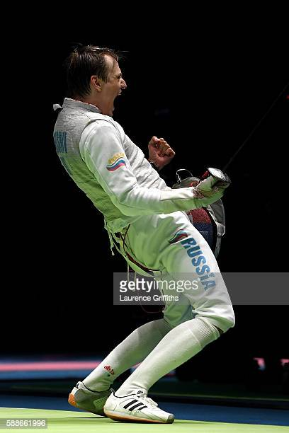 Alexey Cheremisinov of Russia celebrates after defeating JamesAndrew Davis of Great Britain during a Men's Foil Team Quarterfinal bout on Day 7 of...