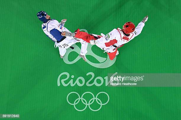 Alexey Denisenko of Russia competes against Ahmad Abughaush of Jordan during the men's 68kg Gold Medal Taekwondo contest at the Carioca Arena on Day...