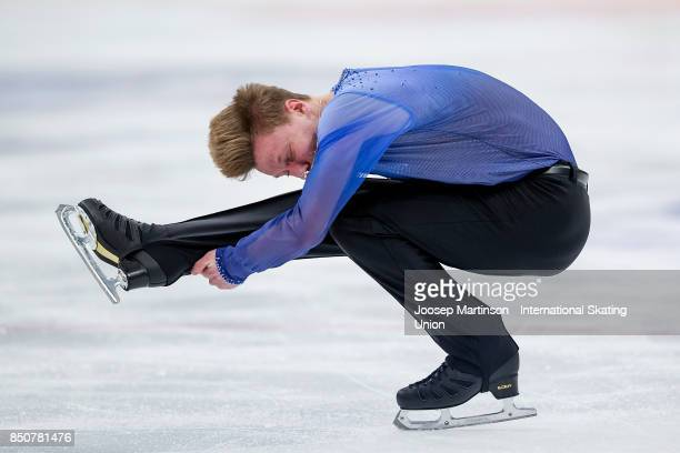 Alexey Erokhov of Russia competes in the Junior Men's Short Program during day one of the ISU Junior Grand Prix of Figure Skating at Minsk Arena on...
