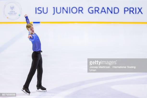 Alexey Erokhov of Russia competes in the Men's Short Program during day one of the ISU Junior Grand Prix of Figure Skating at Olivia Ice Rink on...