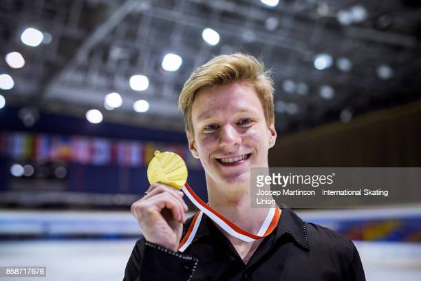 Alexey Erokhov of Russia poses in the Men's medal ceremony during day three of the ISU Junior Grand Prix of Figure Skating at Olivia Ice Rink on...