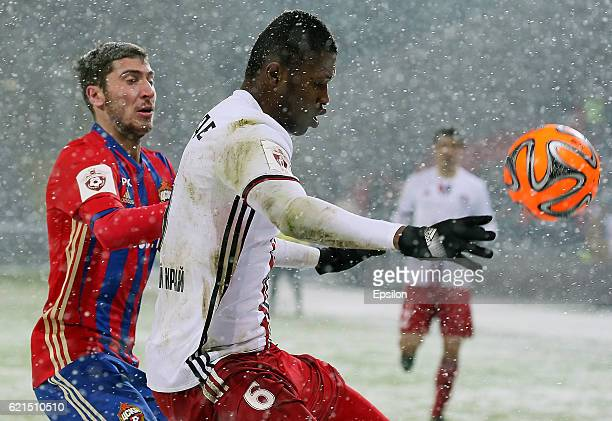 Alexey Ionov of PFC CSKA Moscow challenged by Sekou Conde of FC Amkar Perm during the Russian Premier League match between PFC CSKA Moscow and FC...
