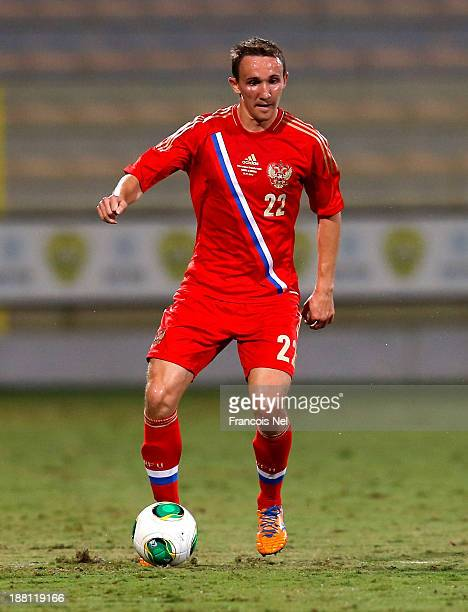 Alexey Kozlov of Russia in action during the International Football match between Serbia and Russia at the Zabeel Stauduim on November 15 2013 in...