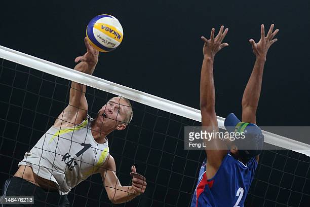 Alexey Kuleshov of Kazakhstan competes against Fahriansyah Fahriansyah of Indonesia during the Beach Volleyball Men's semifinal match on Day 1 of the...