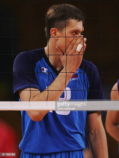 Alexey Kuleshov of Russia whispers instructions against United States in the men's indoor Volleyball preliminary match on August 19 2004 during the...